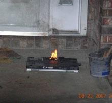 Burning Inspiron - image courtesy Doug Brown/ConsumerAffairs.com