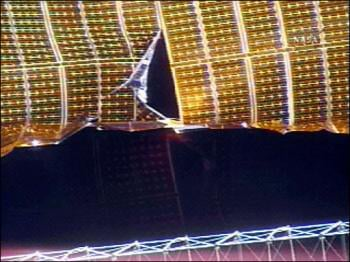 Ripped solar array, courtesy NASA