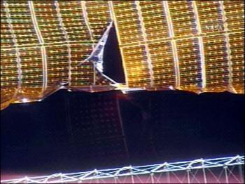 Ripped solar array, courtesy NASA