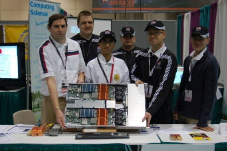 Shot of the Alberta team holding their SGI system