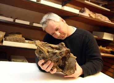 PhD student Mike Taylor and his fossil friend. Credit: NHM