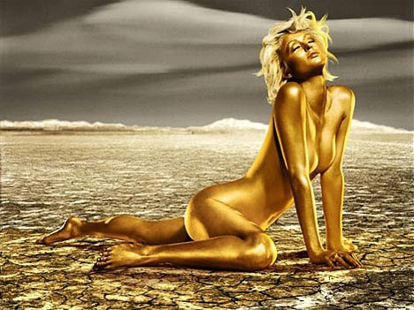 Paris Hilton naked, covered in gold paint and in the desert