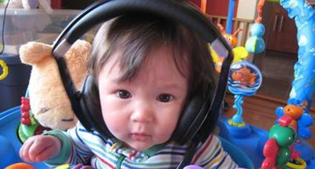 Shot of a wee lass with headphones