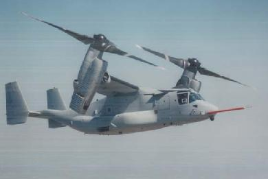 The V-22 with rotors tilting