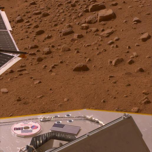 View of Phoenix on Mars showing US flag and mini-DVD
