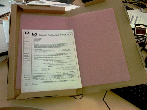 A smaller box containing two sheets of A4 paper