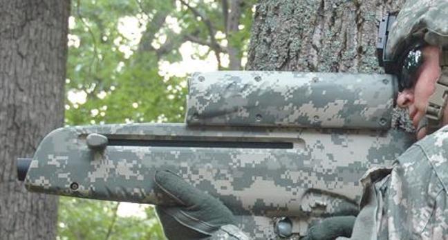 The XM-25 wireless smartshell gun in an Army press shot