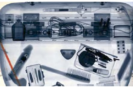 X-ray image showing vibrator in passenger's luggage
