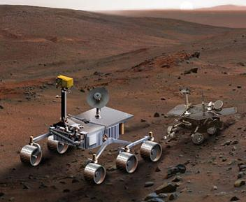 The new MSL mega-rover next to one of the current ones