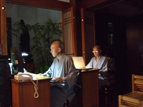 Monks at their laptops