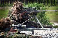 Royal Marine snipers practicing with AI .338 rifles