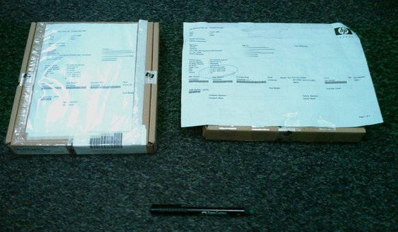 The two boxes each containing a replacement DIMM