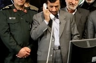 Iranian President Mahmoud Ahmadinejad receives news of the successful 'Omid' launch
