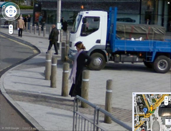 Street View grab showing ghost is actually woman in fancy dress