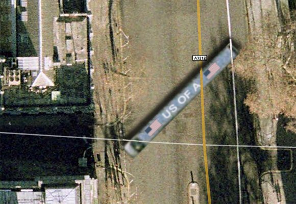 Obama's limo attempts to enter Downing Street, as seen on satellite image
