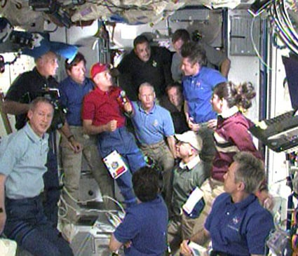 Discovery and Expedition 20 crew bid farewell. Pic: NASA