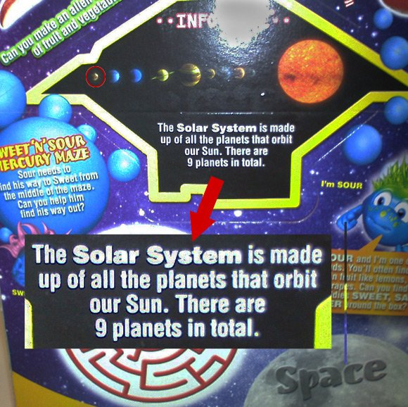 Happy Meal box showing nine planets, including Pluto