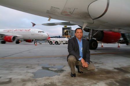 Ravi Simhambhatla on the tarmac at SFO, photo: Gavin Clarke