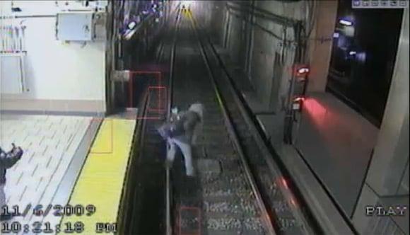 CCTV view of woman falling onto train tracks