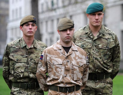 British soldiers model the new MTP (left and right) and existing desert kit (centre). Credit: British Army