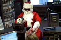 Surveillance image of Santa stick-up