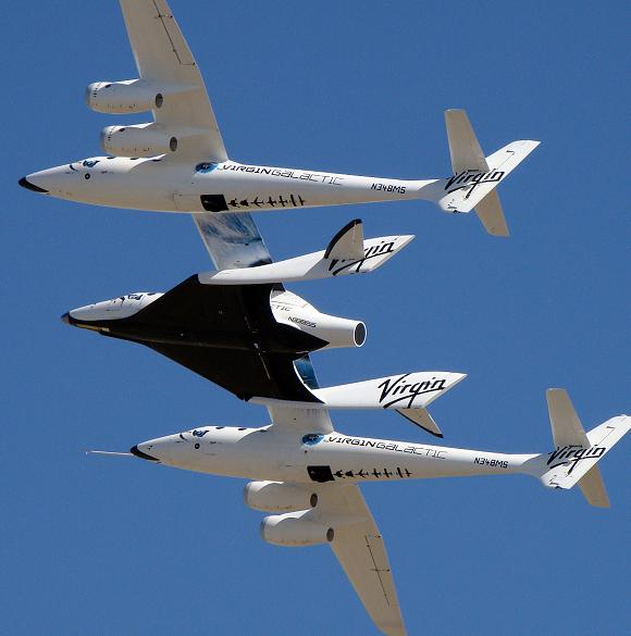 The SpaceShipTwo craft takes to the air carried by its WhiteKnightTwo mothership. Credit: Virgin Galactic