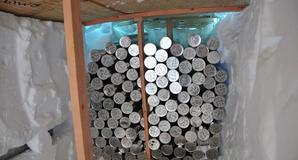 Ice cores stored in a snow trough at the Bruce Plateau camp. Credit: Ellen Mosley-Thompson, OSU