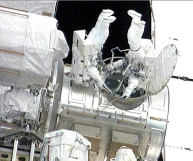 Steve Bowen (right) and Garrett Reisman exit the ISS. Pic: NASA TV