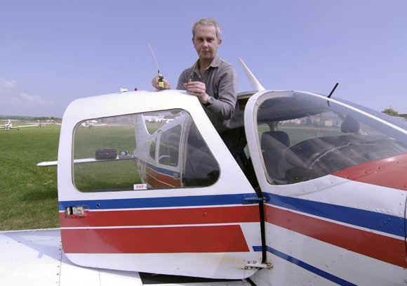 Steve Daniels poses with the Vulture 1 GPS board