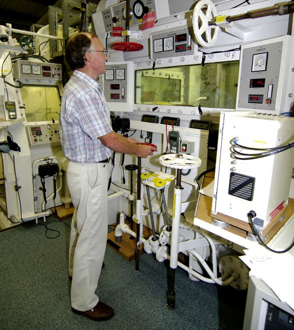 Chas Taylor operating the hypobaric chamber