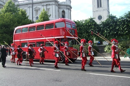 Pikemen overtaking a bus outside St. Paul's Cathedral, London