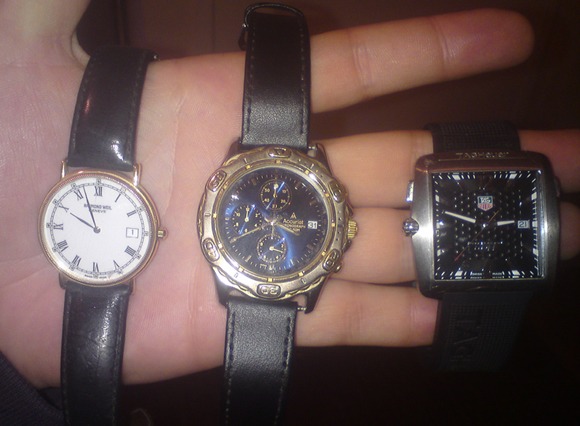 Photograph of Taylor holding the watches