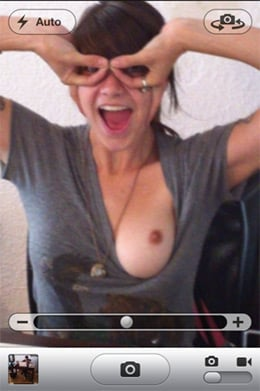 Screen grab from iPhone 4 showing young lady with exposed breast