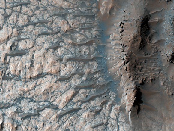 The floor of a large impact crater in the Martian southern highlands, north of the giant Hellas impact basin. Credit: NASA/JPL/University of Arizona