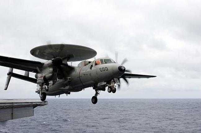 An E-2C Hawkeye assigned to the Black Eagles of Airborne Early Warning Squadron (VAW) 113 launches from the flight deck of the aircraft carrier USS Ronald Reagan (CVN 76). Credit: US Navy/Mass Communication Specialist 2nd Class Joseph M. Buliavac