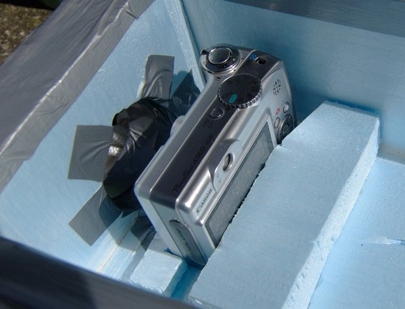 The Canon stills camera inside the main payload box