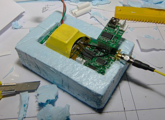 The GPS/APRS board mounted in styrofoam