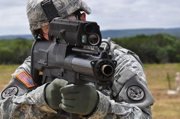 A soldier aims an XM-25 smartgun. Credit: PEO Soldier