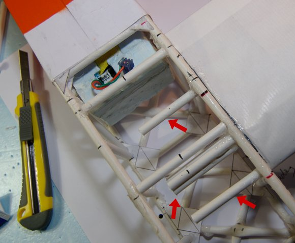 The first wing glued in, with the spars indicated