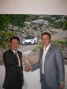 handshake for Tesla Panasonic deal