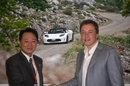 handshake for Tesla Panasonic deal
