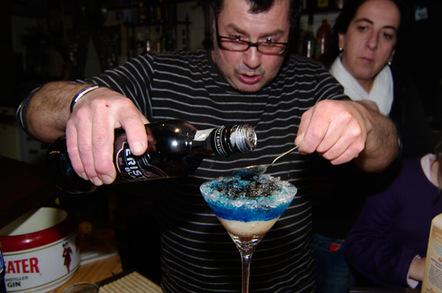 Carefully add the black vodka