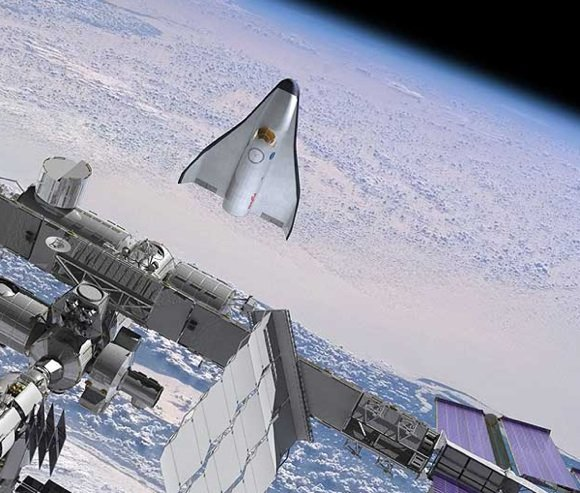 The proposed CCDev spaceplane from Orbital Sciences pictured during ISS operations. Credit: OSC