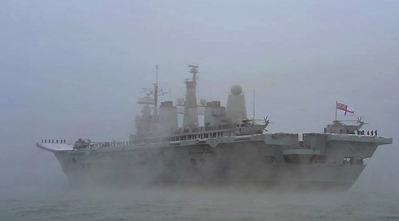 HMS Ark Royal flies her decommissioning pennant as she enters Portsmouth for the last time. Credit: MoD