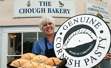 Cornish maiden bearing platter of genuine Cornish pasties. Photo: Cornish Pasty Association