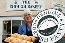 Cornish maiden bearing platter of genuine Cornish pasties. Photo: Cornish Pasty Association