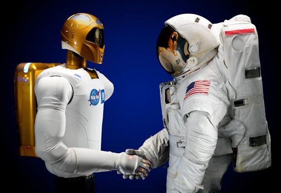 Robonaut shakes hands with with his human counterpart. Pic: NASA
