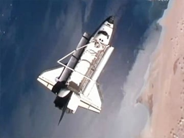 Discovery performs its flyaround of the International Space Station as both spacecraft orbit over the Sahara Desert. Pic: NASA TV