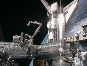 Discovery docked with the ISS during mission STS-133. Pic: NASA TV