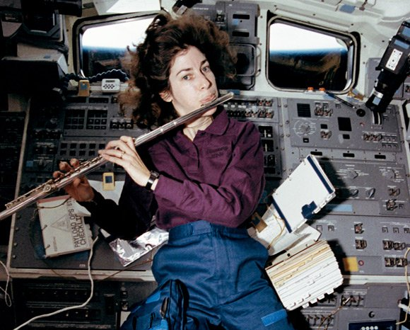 Ellen Ochoa plays the flute in space shuttle Discovery's aft flight deck in April 1993. Pic: NASA